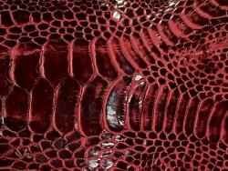 Détail grain naturel patte de coq bordeaux cuir en stock