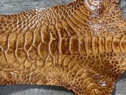 Détail grain de peau cuir patte de coq fauve bijoux accessoire luxe exotique Cuir en stock