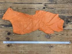 Grand morceau de cuir d'autruche orange avec des picots Cuir en stock