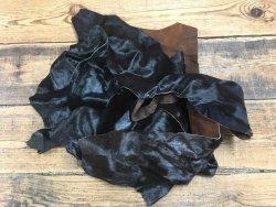 Chutes de cuir de vache poil noir et brun